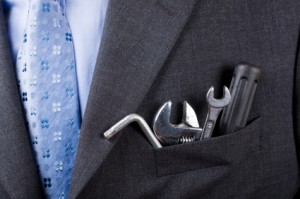Businessman with concept toolkit